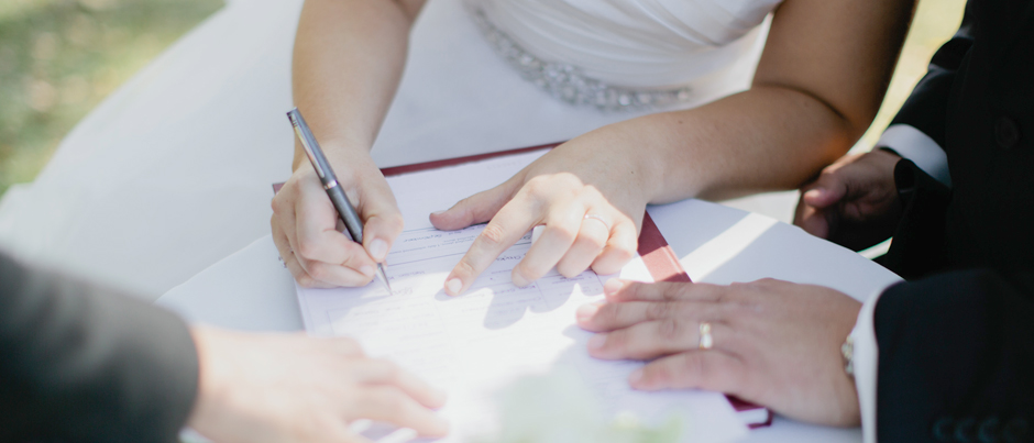 Mature couple receiving training and signing paperwork that explain the different marriage options.